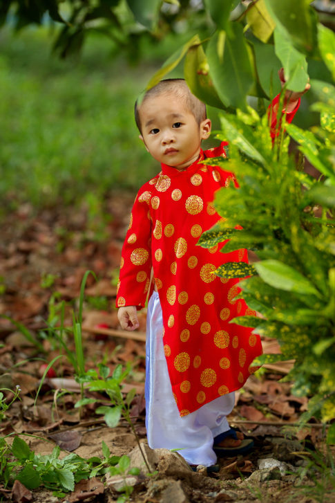 Kid with traditional clothes Ao Dai - Vietnam
