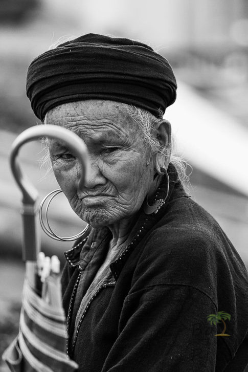 Old woman and umbrella