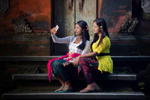 Girls take a selfie - Tirta Empul, Bali