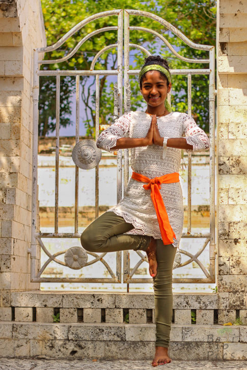 Woman in front of the Uluwatu Temple - Bali